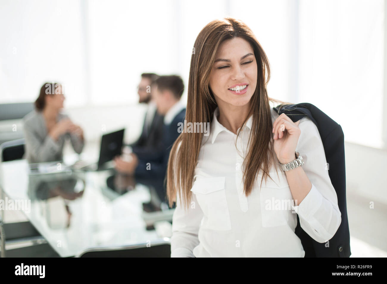 successful business woman on the background of the office - Stock Image