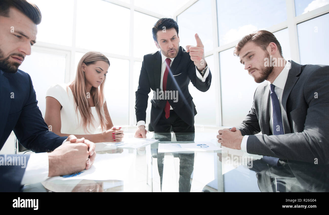 businessman makes a strict reprimand to the employee - Stock Image
