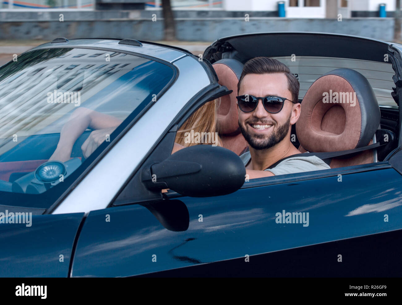 handsome man in a luxury car - Stock Image
