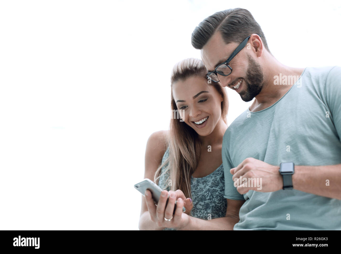 close up.a couple in love discussing video on a smartphone Stock Photo