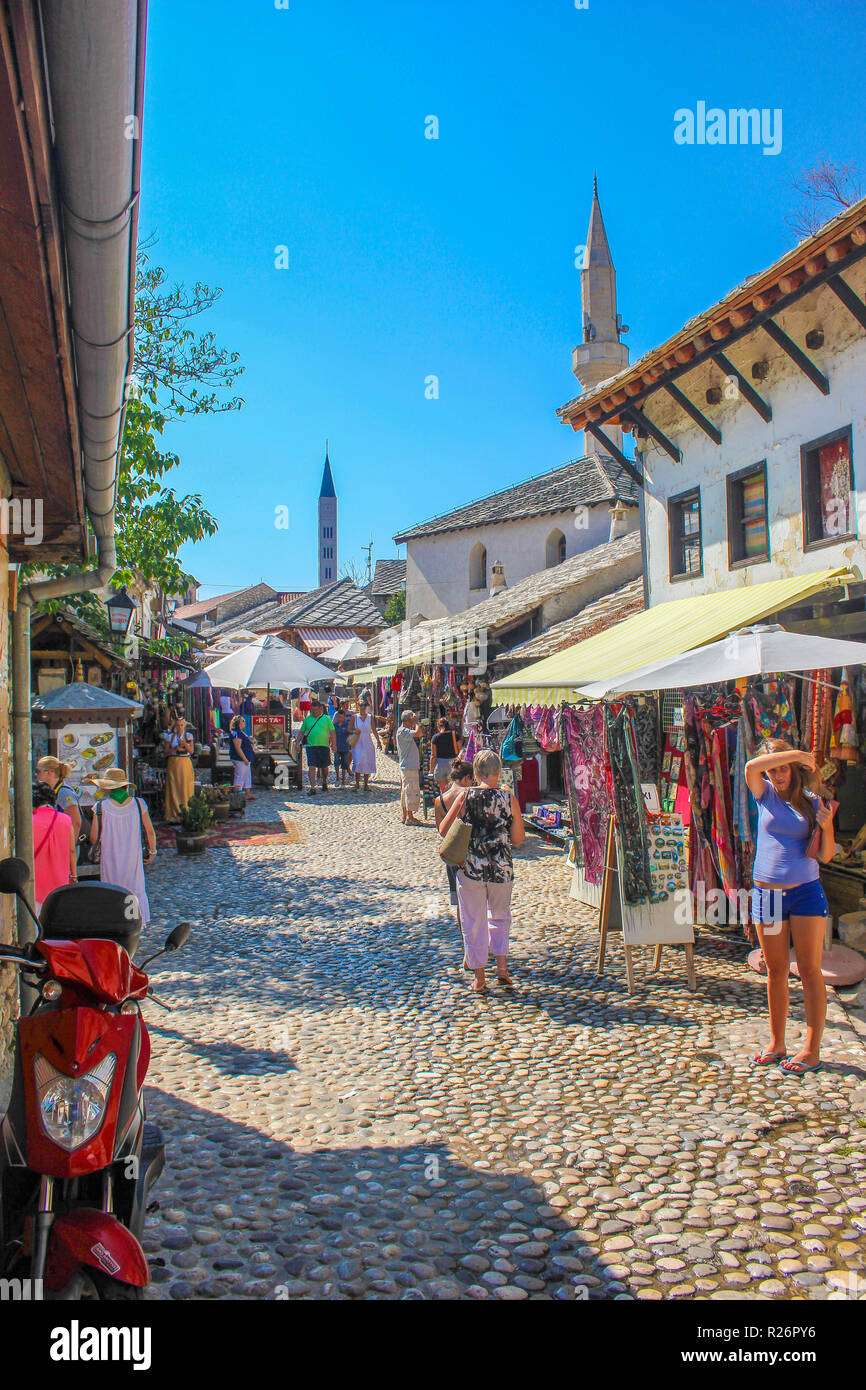 August 2013, Mostar.  Tourists relaxing & shopping in the cobbled streets in the historic part of the city. Stock Photo