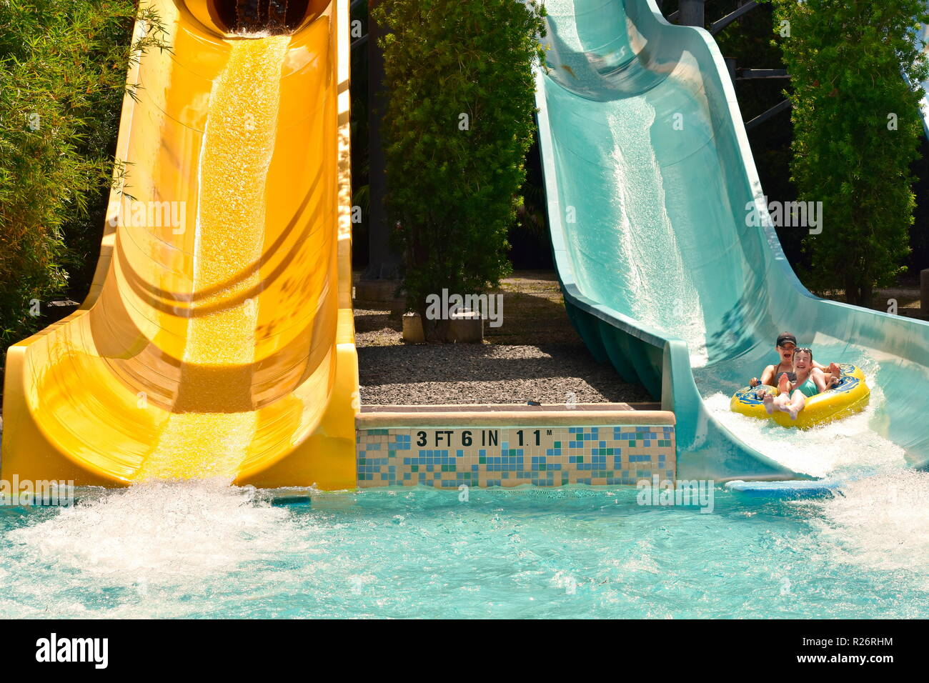 Orlando, Florida. October 26, 2018  Little girls colorful slide water ride at Water Park in International Drive area. - Stock Image