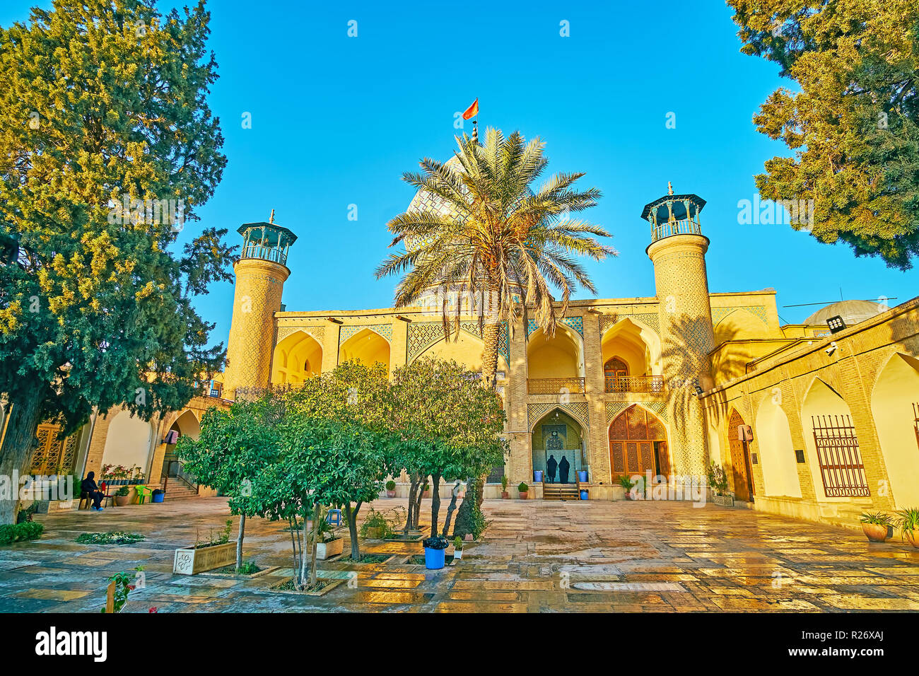 Visit Imamzadeh Ali Ibn Hamzeh Holy Shrine, famous for its traditional Persian architecture and ornate exterior decorations of brick, glazed tile, mos - Stock Image