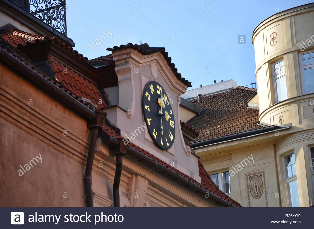 Clock with Hebrew numbers on a synagogue in Prague, closeup, Jewish district, architecture, - Stock Image
