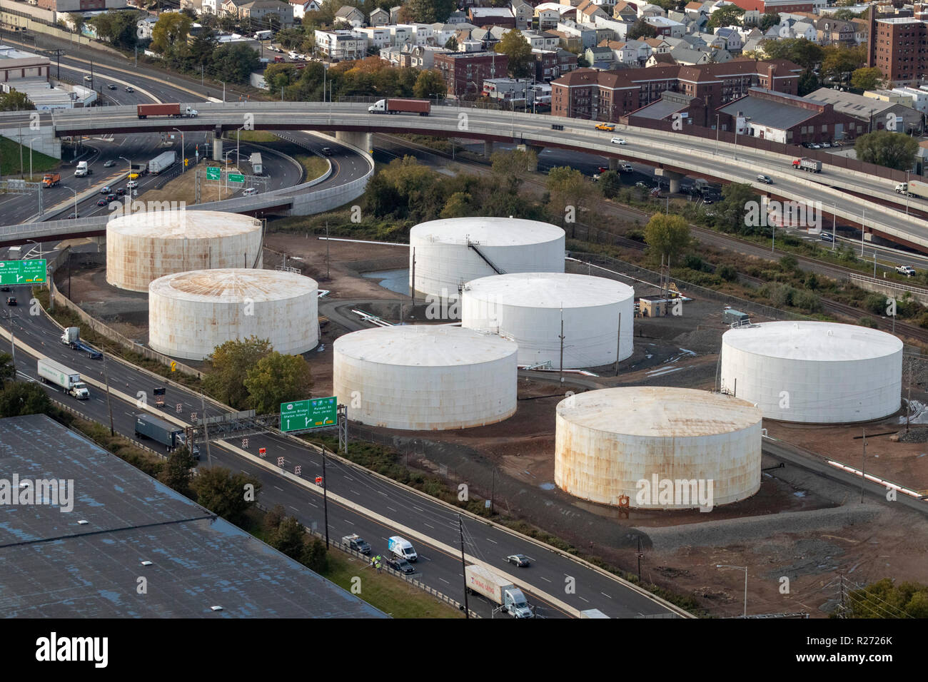 helicopter aerial view of storage tanks, Bayonne, Jersey City, New Jersey, USA - Stock Image