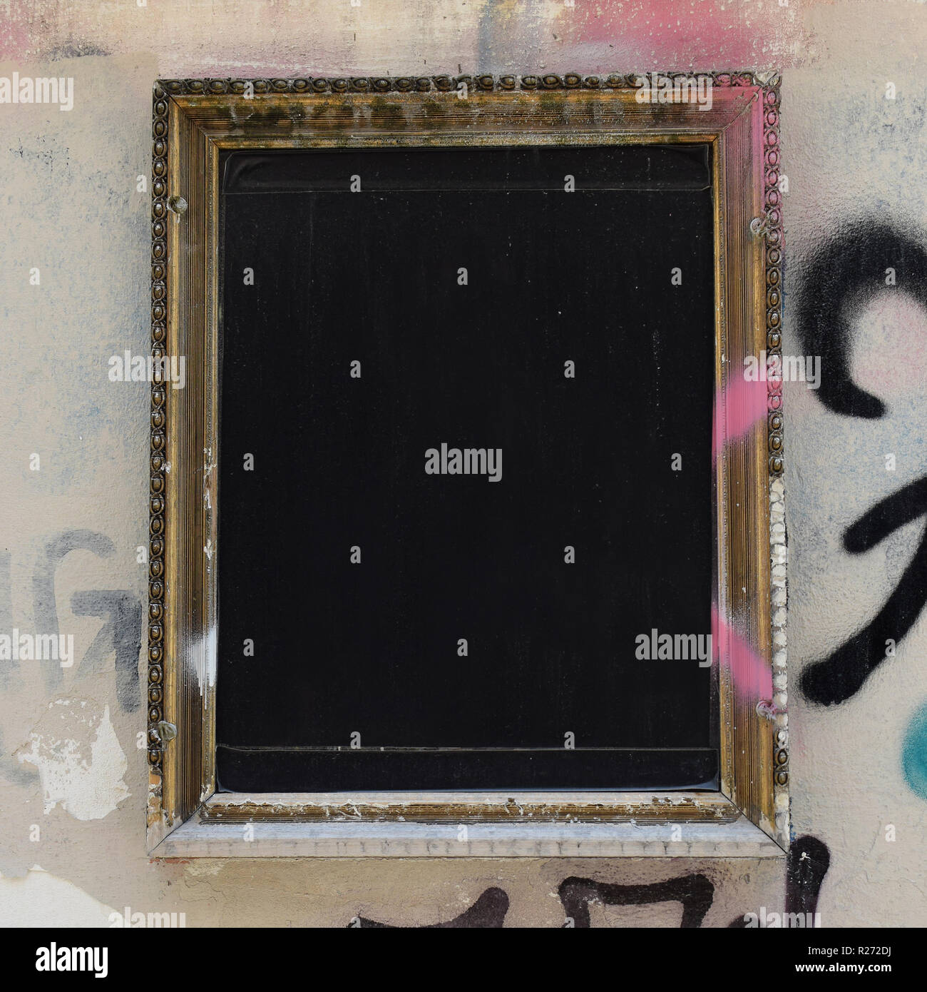 Blank Wooden Picture Frame On Grungy Spray Painted Wall Background