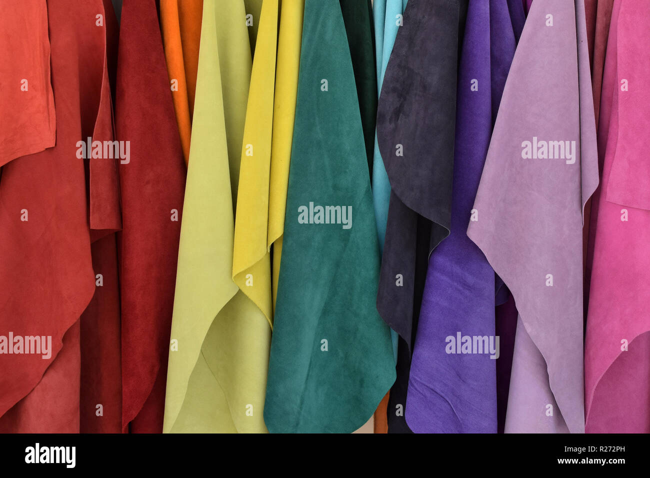 Textiles in various colors material texture. Abstract colorful background. - Stock Image