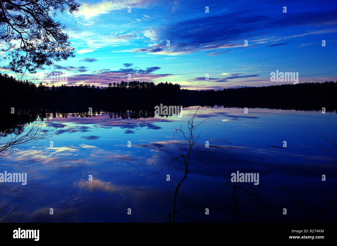 Beautiful sunset over a lake in Dalarna in Sweden - Stock Image