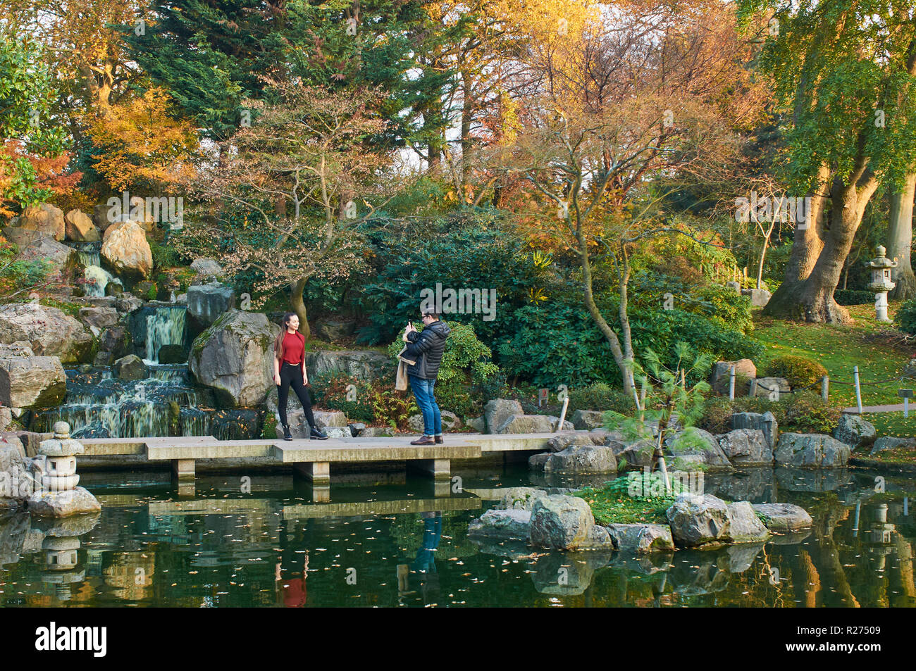 Sightseers in the Kyoto Garden, Holland Park, West London UK - Stock Image