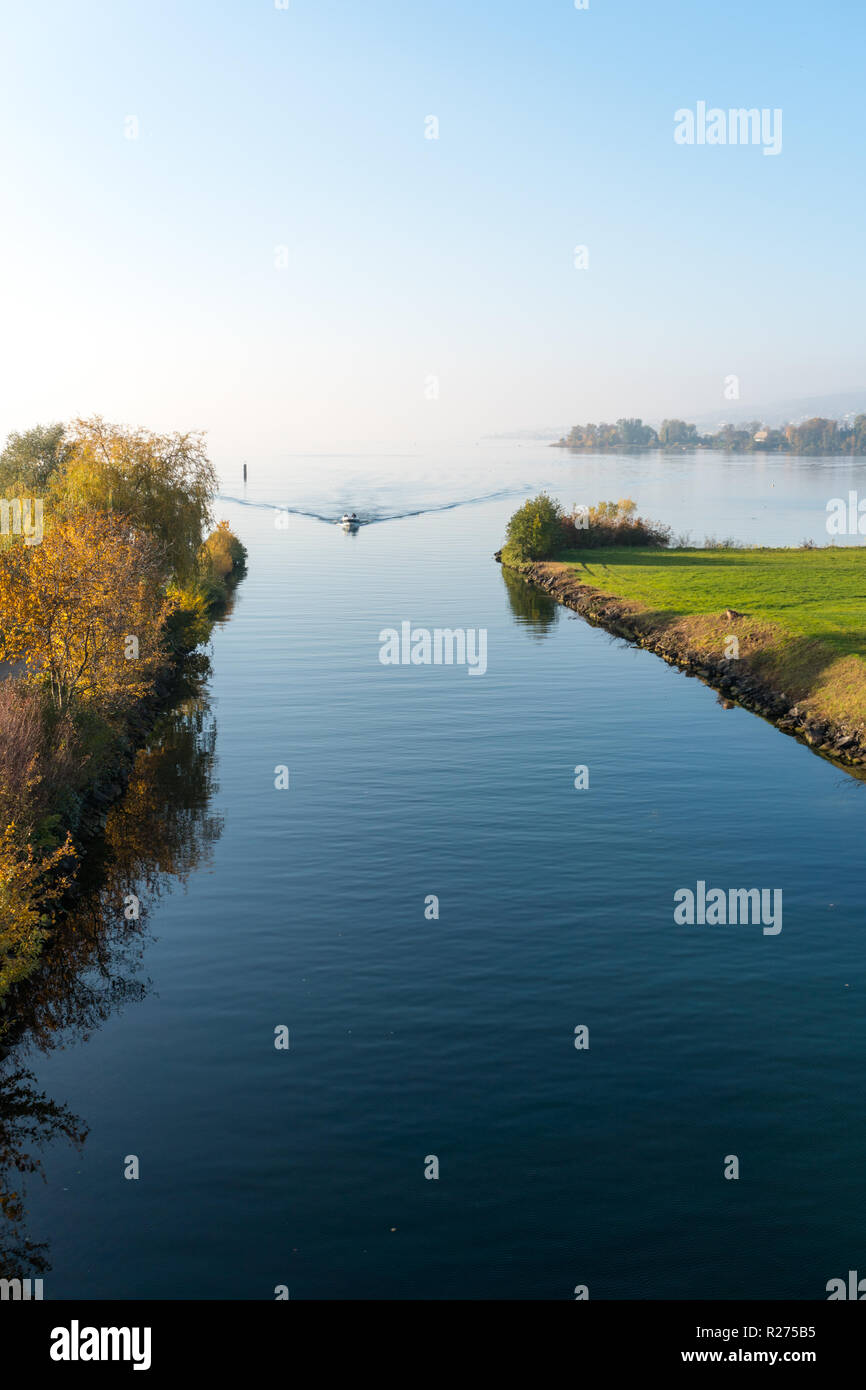 Rapperswil, SG / Switzerland - November 5, 2018: motorboat with tourist people passes from the lower to the upper Lake Zurich through the locks and pa - Stock Image