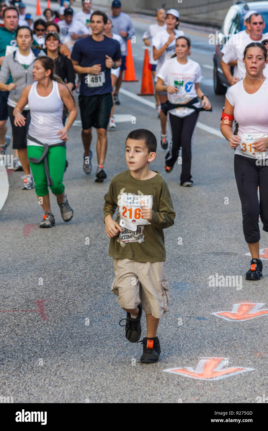 Miami Beach Florida Blue Cross and Blue Shield Tropical 5K Run race runner sports fitness boy child road race competition athlet - Stock Image