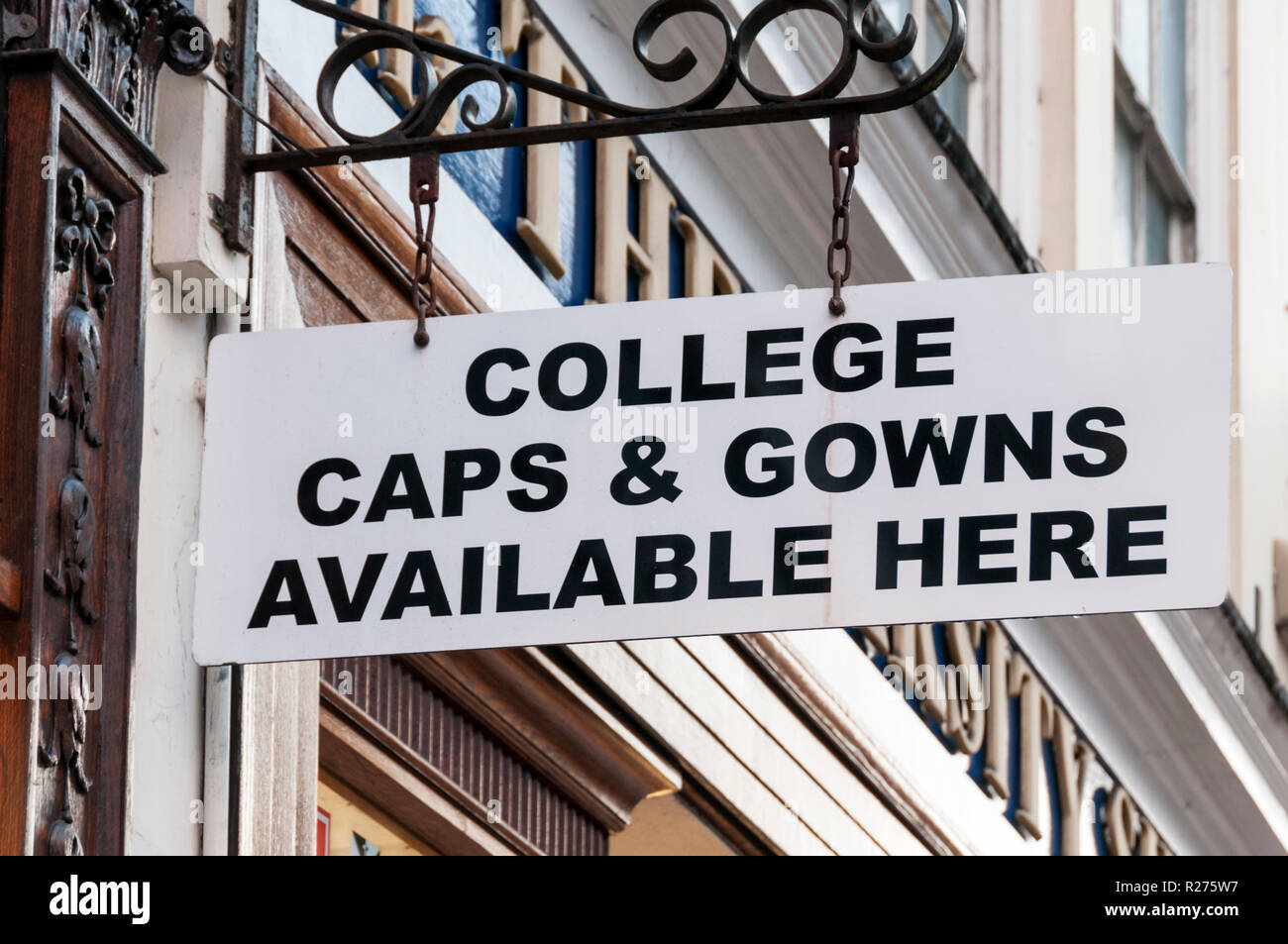 A sign in Oxford reads College Caps & Gowns available here. - Stock Image