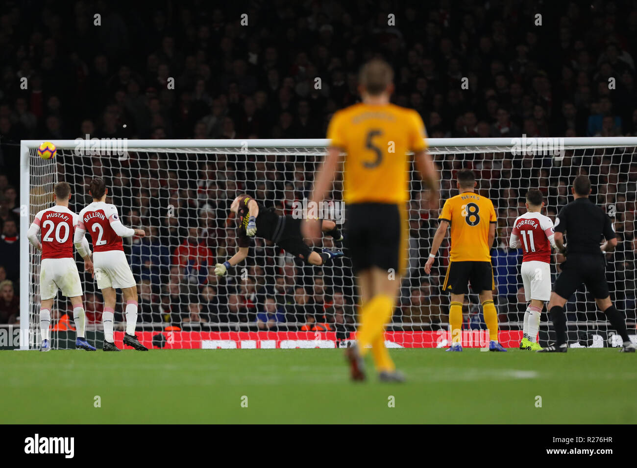 Morgan Gibbs-White of Wolverhampton Wanderers bounces a shot off the inside of the goal from with Bernd Leno of Arsenal beaten - Arsenal v Wolverhampt - Stock Image