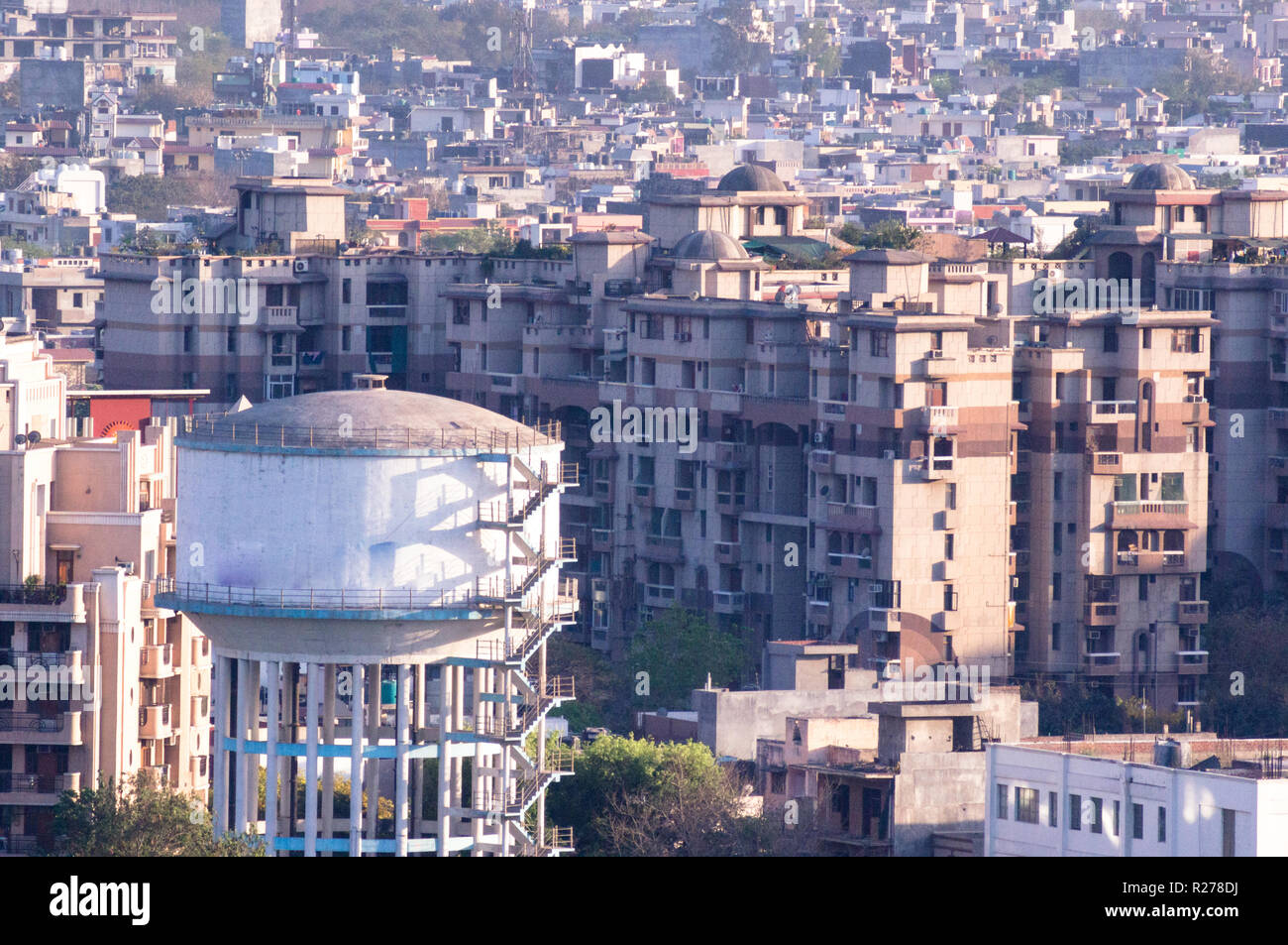 Aerial shot of water tower in the middle of locality - Stock Image