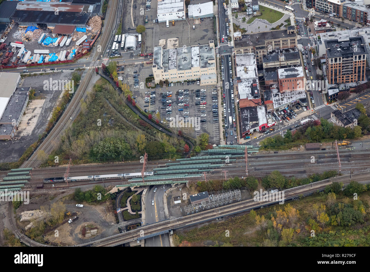 helicopter aerial view of railway line between Hoboken and Jersey City, New Jersey, USA - Stock Image