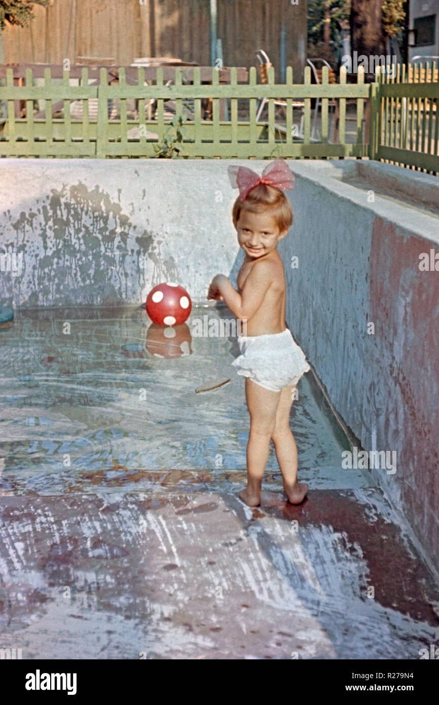 Young Girl Plays In Small Garden Swimming Pool 1950s Hungary Stock