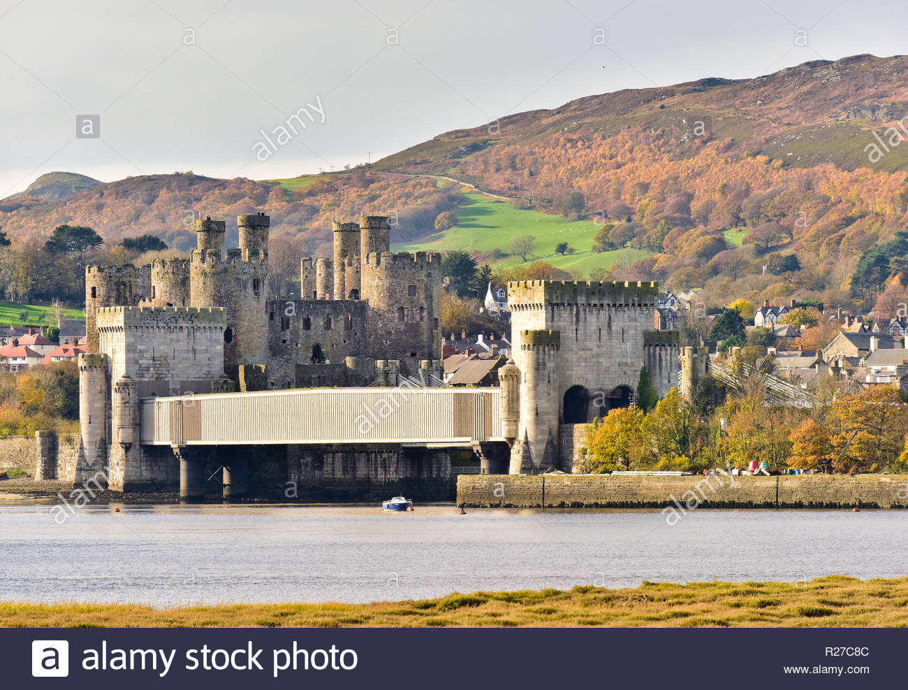 The Grade 1 listed Conwy railway bridge designed by Robert Stephenson with Conwy Castle and Conwy Mountain behind. Conwy County Borough, Wales, UK. Stock Photo