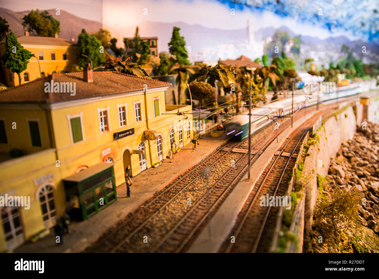 Model of small railway station with train approaching - Stock Image