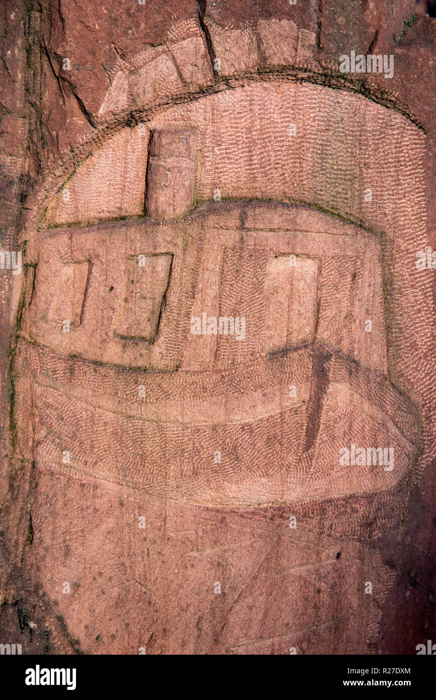 Standing stone with narrow boat engraving in Middlewich Cheshire UK - Stock Image