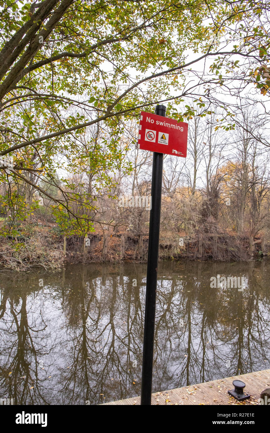 No swimming sign on the banks of the river weaver in Winsford Cheshire UK Stock Photo