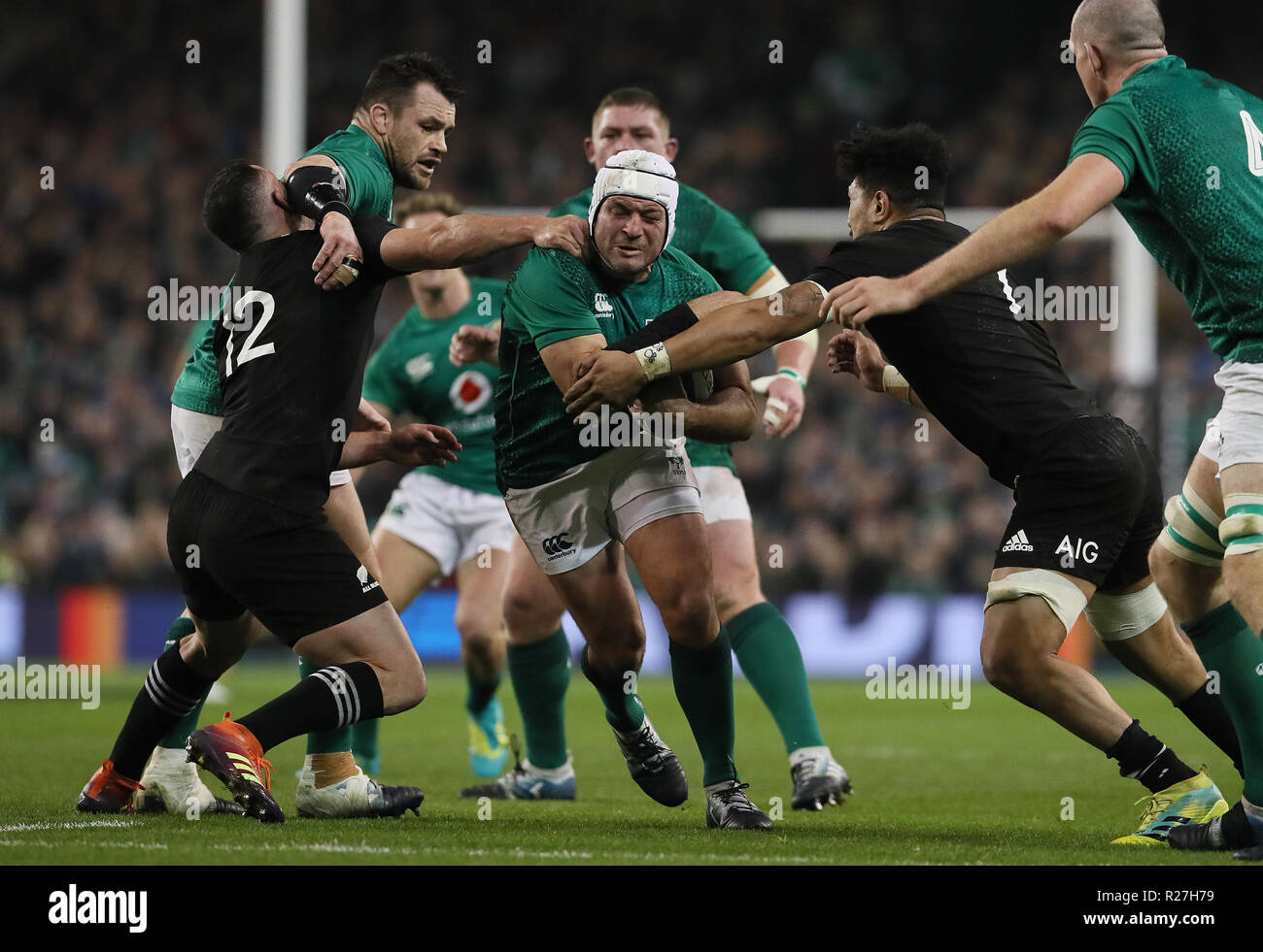 Ireland's Rory Best tackled by New Zealand's Ryan Crotty(left) and Ardie Savea during the Autumn International match at the Aviva Stadium, Dublin. - Stock Image