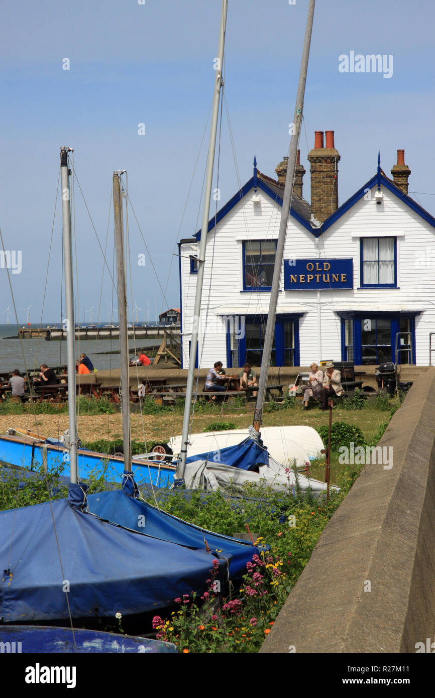 Sailing boats on the beach at the Kent seaside resort of Whitstable a fishing port on the Kent coast of England - Stock Image