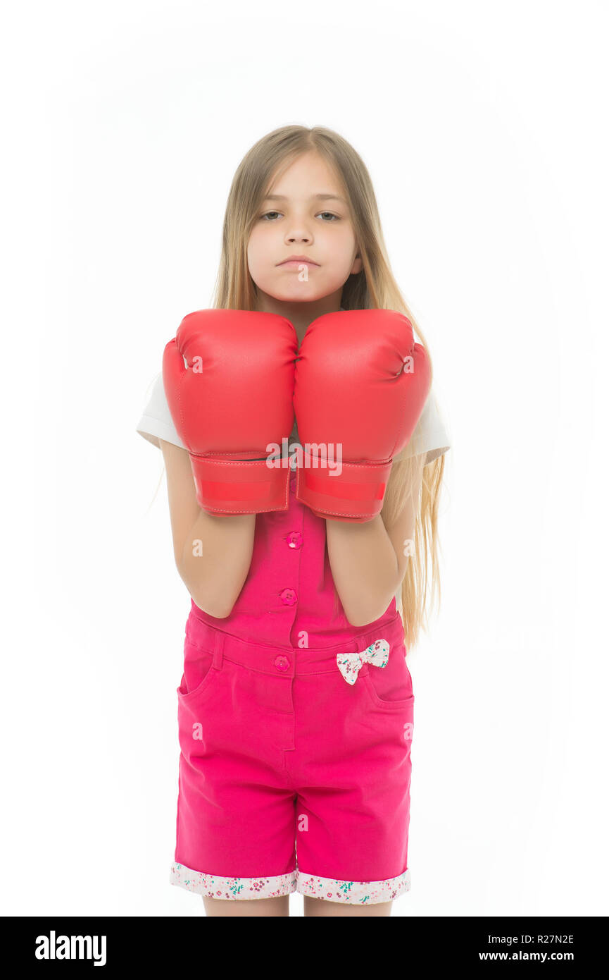 Girl in red boxing gloves isolated on white  Little child smile and