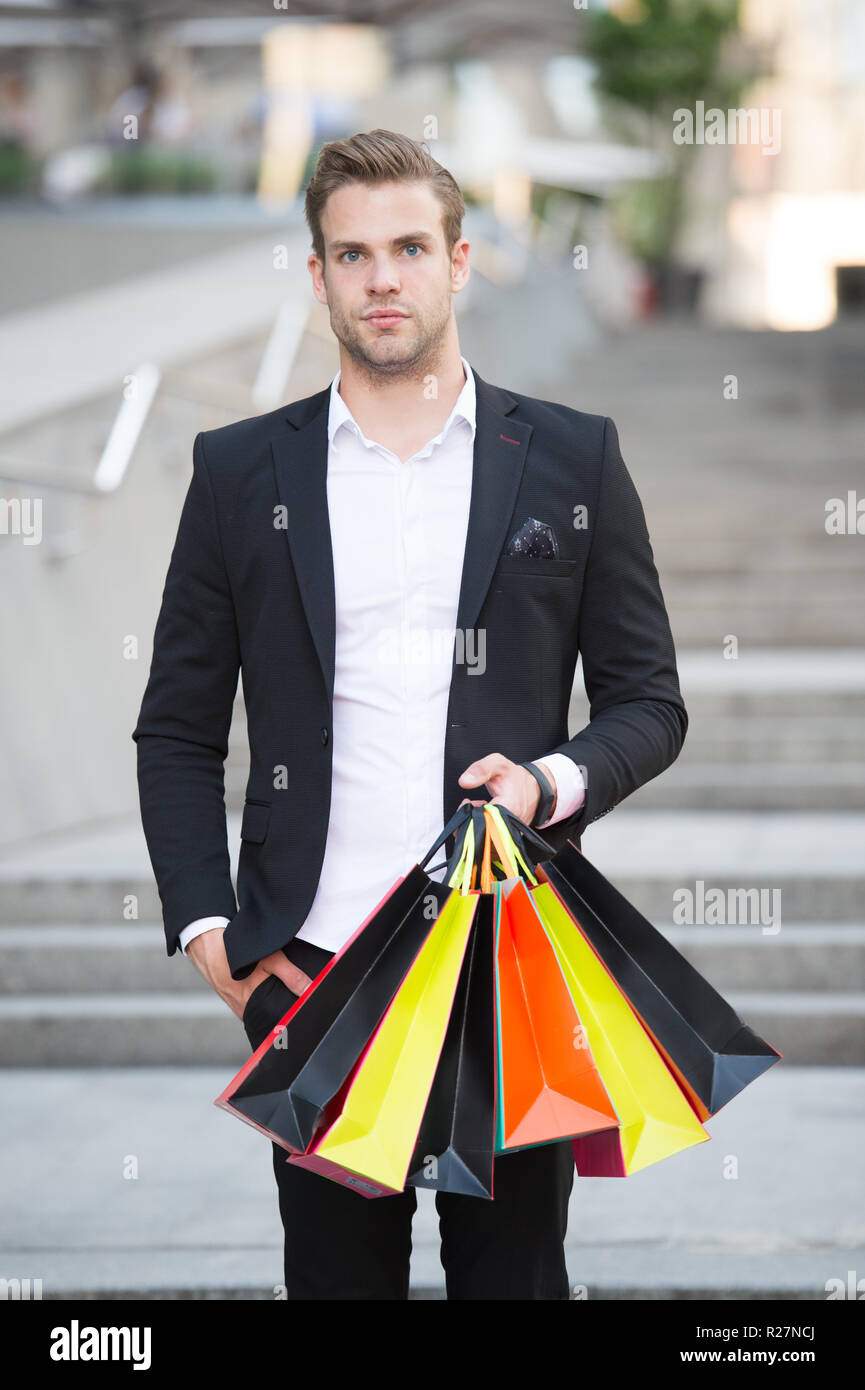 Shop alone. People find shopping partners more akin accomplices in crime. Man carry shopping bag. Guy shopped alone bought exactly what he needs. Alone shopping benefits. - Stock Image