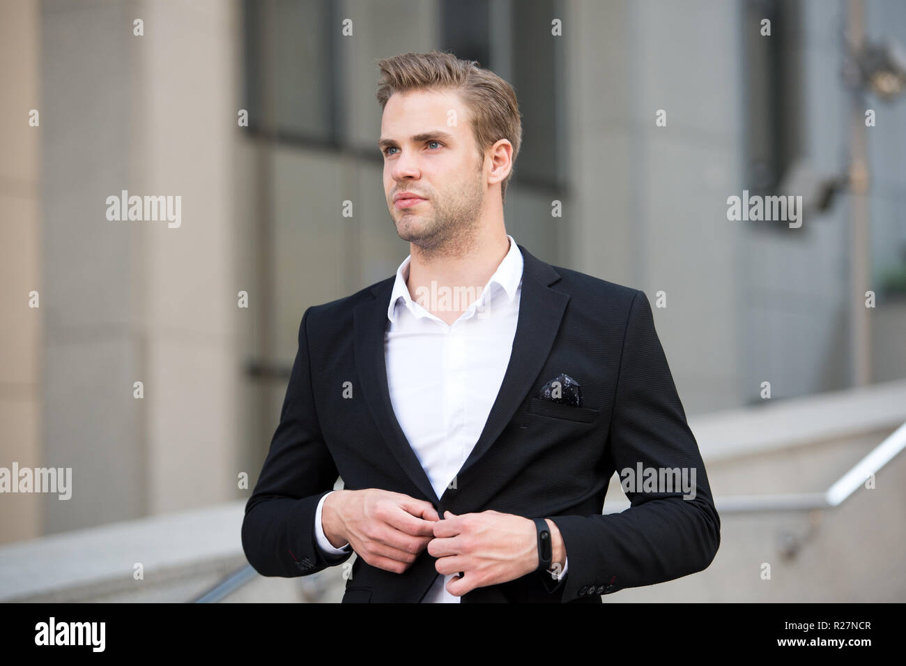 Uniform business environments decorum professionalism woven culture organization. Man formal suit businessman well groomed urban background. Professional attire wear in professional environments. - Stock Image