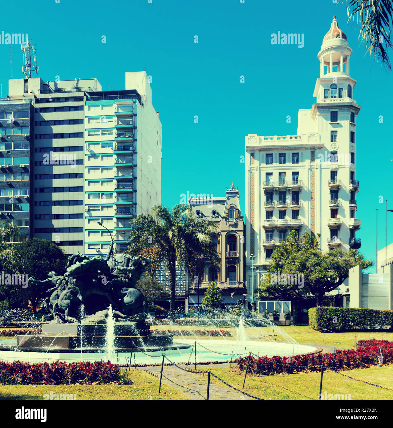 Plaza Juan Pedro Fabini with historic memorial to heroes and fountain in center of Montevideo. Uruguay, South America Stock Photo