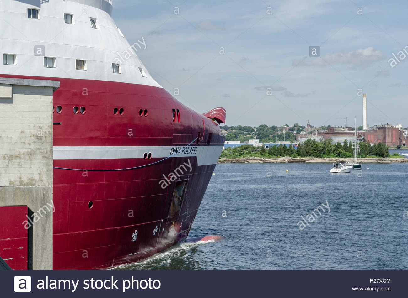 New Bedford, Massachusetts, USA - June 22, 2018: Bow of geotechnical drilling vessel Dina Polaris as it transits New Bedford hurricane barrier - Stock Image