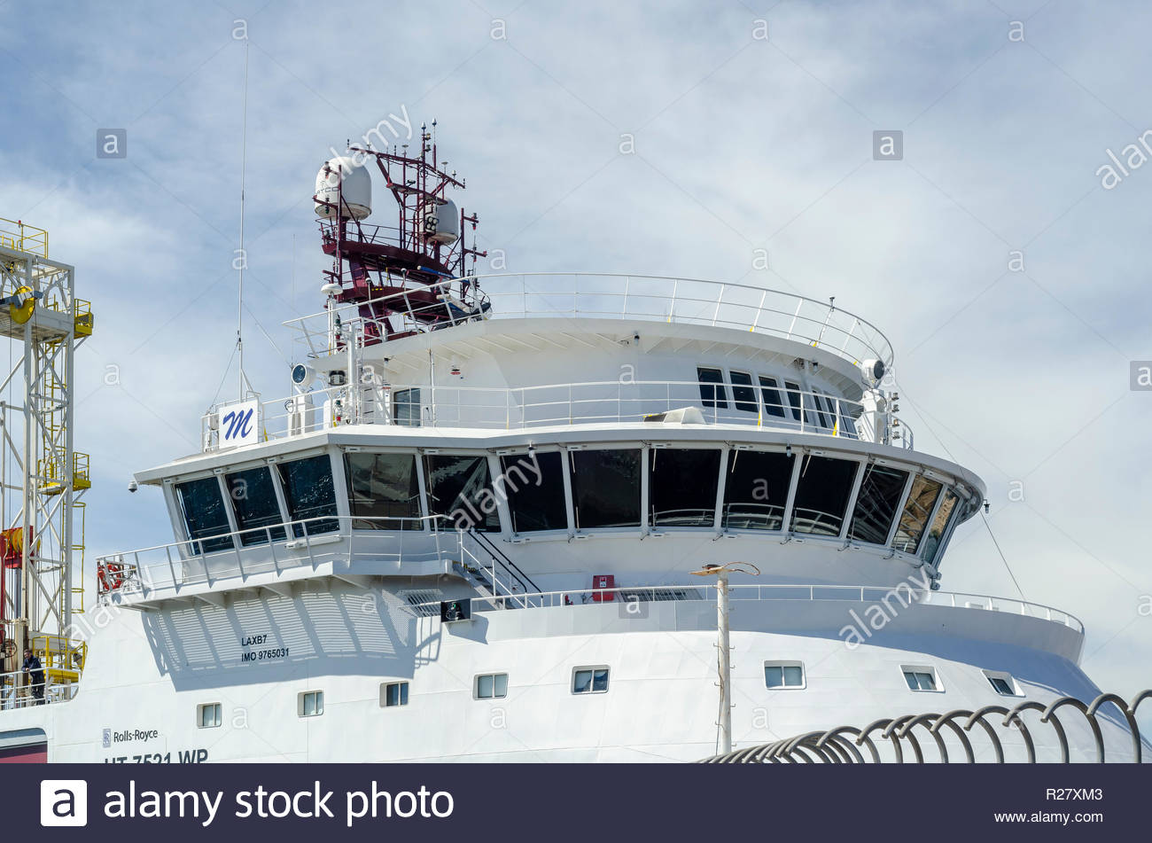 New Bedford, MA, USA - June 22, 2018: Bridge and drill rig of drilling vessel Dina Polaris towering overhead as ship transits hurricane barrier - Stock Image