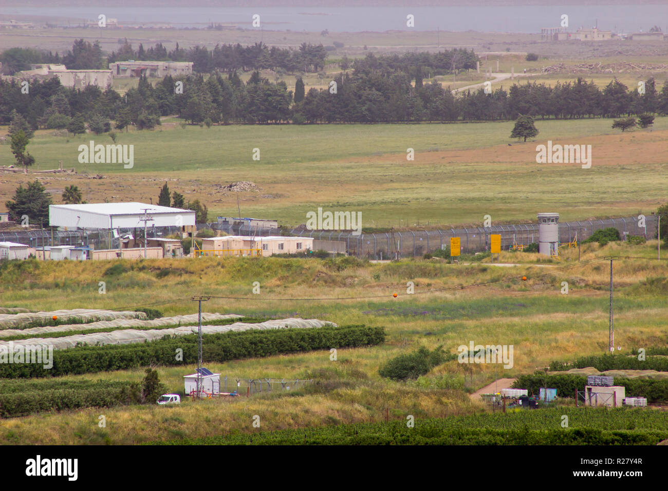 4 May 2018 Syrian real estate close to the Israeli border as seen from the Northern Golan Heights in North East Israel - Stock Image
