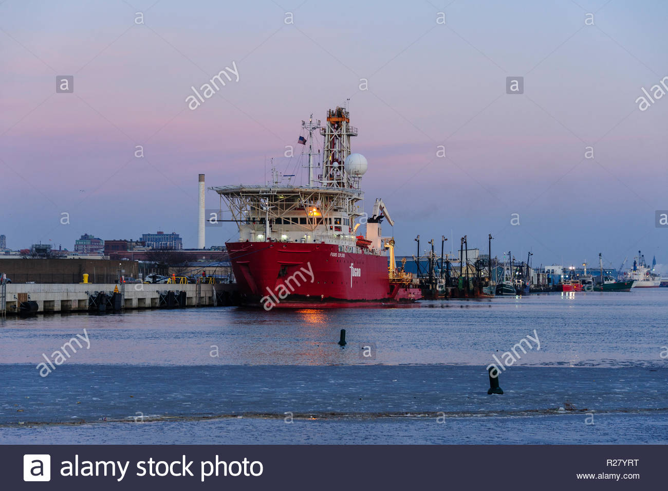 New Bedford, Massachusetts, USA - January 19, 2018: Geotechnical drill ship Fugro Explorer in pre-dawn on icy New Bedford harbor - Stock Image