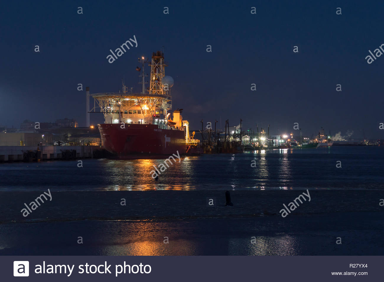New Bedford, Massachusetts, USA - January 19, 2018: Geotechnical drill ship Fugro Explorer preparing for dawn departure from New Bedford - Stock Image
