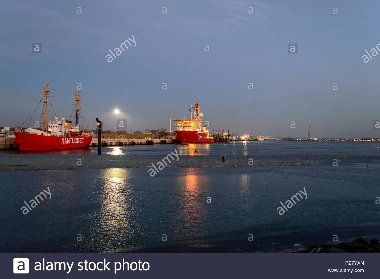 New Bedford, Massachusetts, USA - January 19, 2018: Nantucket Lightship and geotechnical drill ship Fugro Explorer at dawn in icy New Bedford harbor - Stock Image
