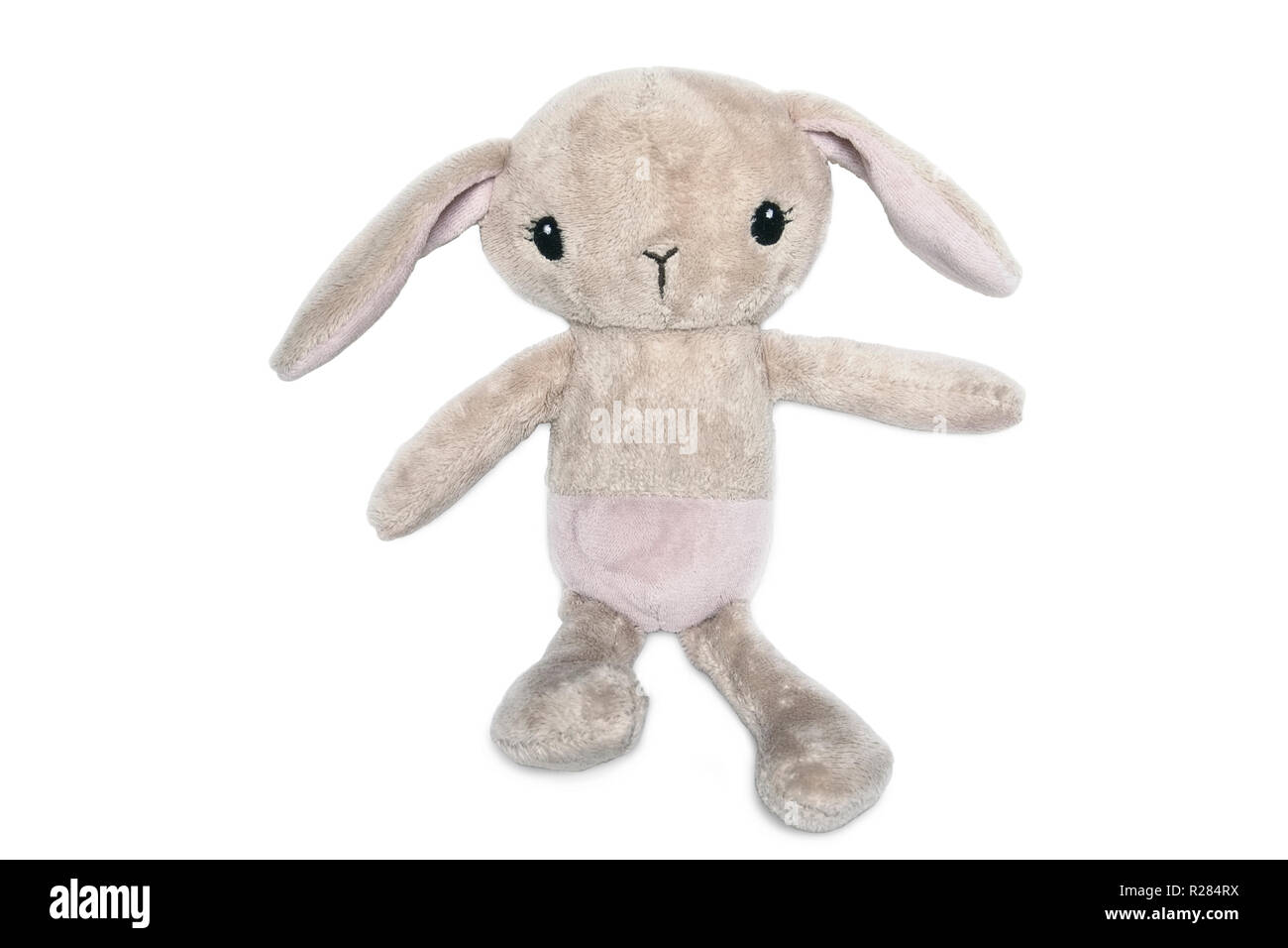The beige plush rabbit is isolated on a white background - Stock Image