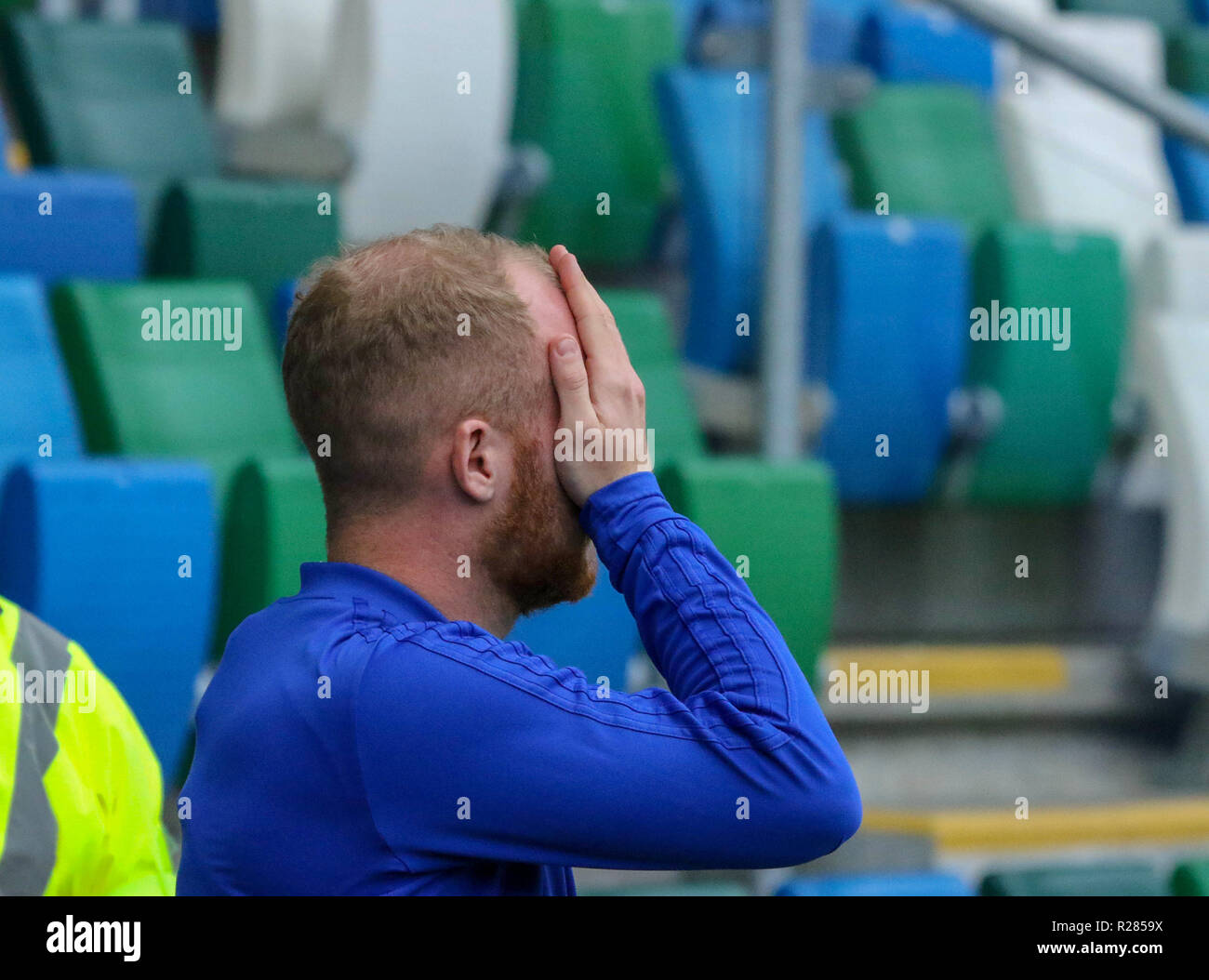 Windsor Park, Belfast, Northern Ireland.17 November 2018. Northern Ireland training in Belfast this morning ahead of their UEFA Nations League game against Austria tomorrow night in the stadium. Liam Boyce jokingly hides his black eye after the injury he sustained midweek against the Republic of Ireland. Credit: David Hunter/Alamy Live News. - Stock Image