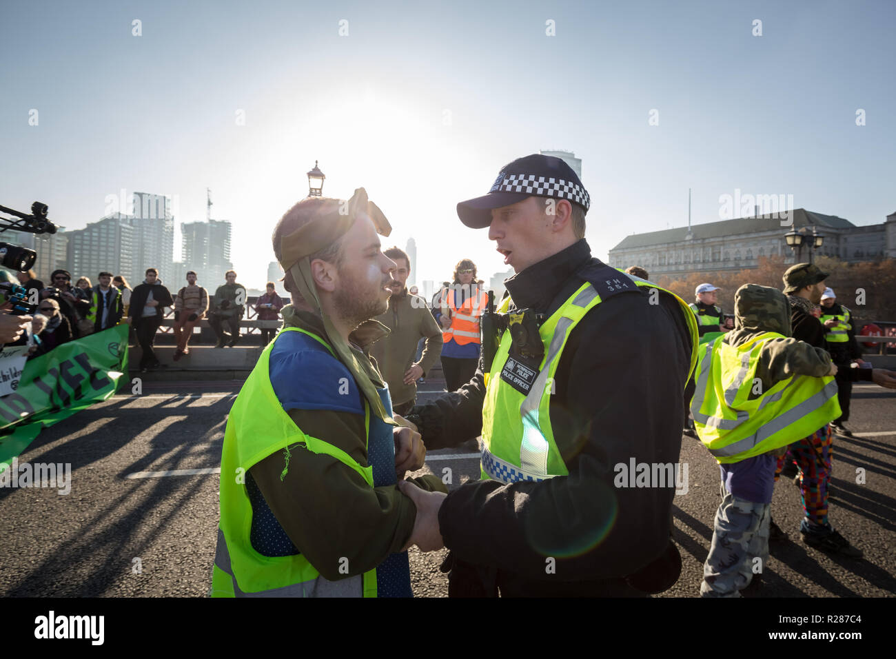 London, UK. 17th November, 2018. Environmental campaigners from Extinction Rebellion block Lambeth Bridge, one of five bridges blocked in central London, as part of a Rebellion Day event to highlight 'criminal inaction in the face of climate change catastrophe and ecological collapse' by the UK Government as part of a programme of civil disobedience during which scores of campaigners have been arrested. Credit: Guy Corbishley/Alamy Live News Stock Photo