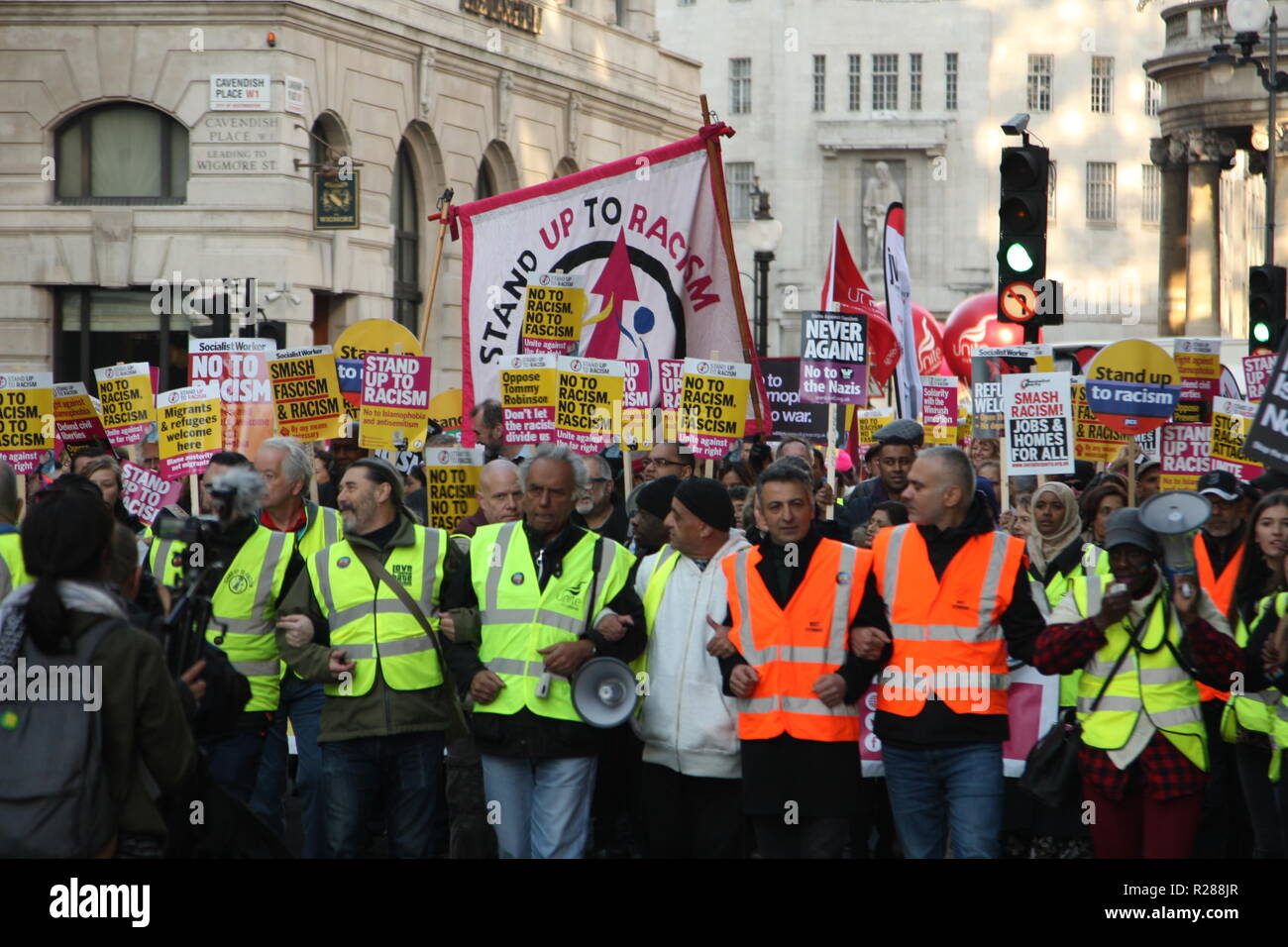 London, UK, 17th November 2018.Thousands of people take to the streets of London to protest against the growth of racism, hate crime and far-right extremism nationally and globally. The march sets out from Portland Place, where the BBC is based, before heading through London to Whitehall. The event is organised by Unite against Fascism, Stand Up to Racism and Love Music Hate Racism and backed by the TUC, which represents the UK's leading Trades Unions. Roland Ravenhill/Alamy Live News - Stock Image