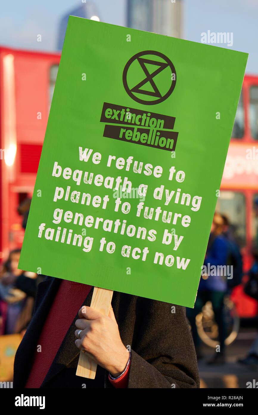 London, UK. - November 17, 2018: A protestor holds a banner during the Extinction Rebellion Climate March. - Stock Image