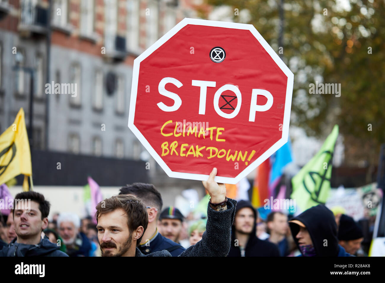 London, UK. - November 17, 2018: A protestor holds a banner during the Extinction Rebellion Climate March. Credit: Kevin J. Frost/Alamy Live News - Stock Image