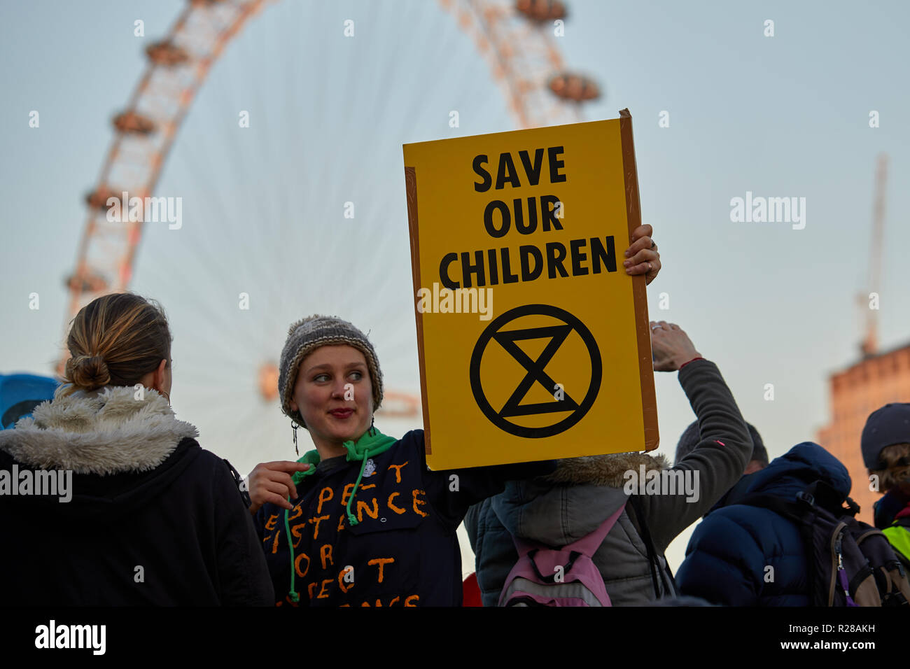 London, UK. - November 17, 2018: A protestor holds a banner on Westminster Bridge during the Extinction Rebellion Climate March. Credit: Kevin J. Frost/Alamy Live News - Stock Image