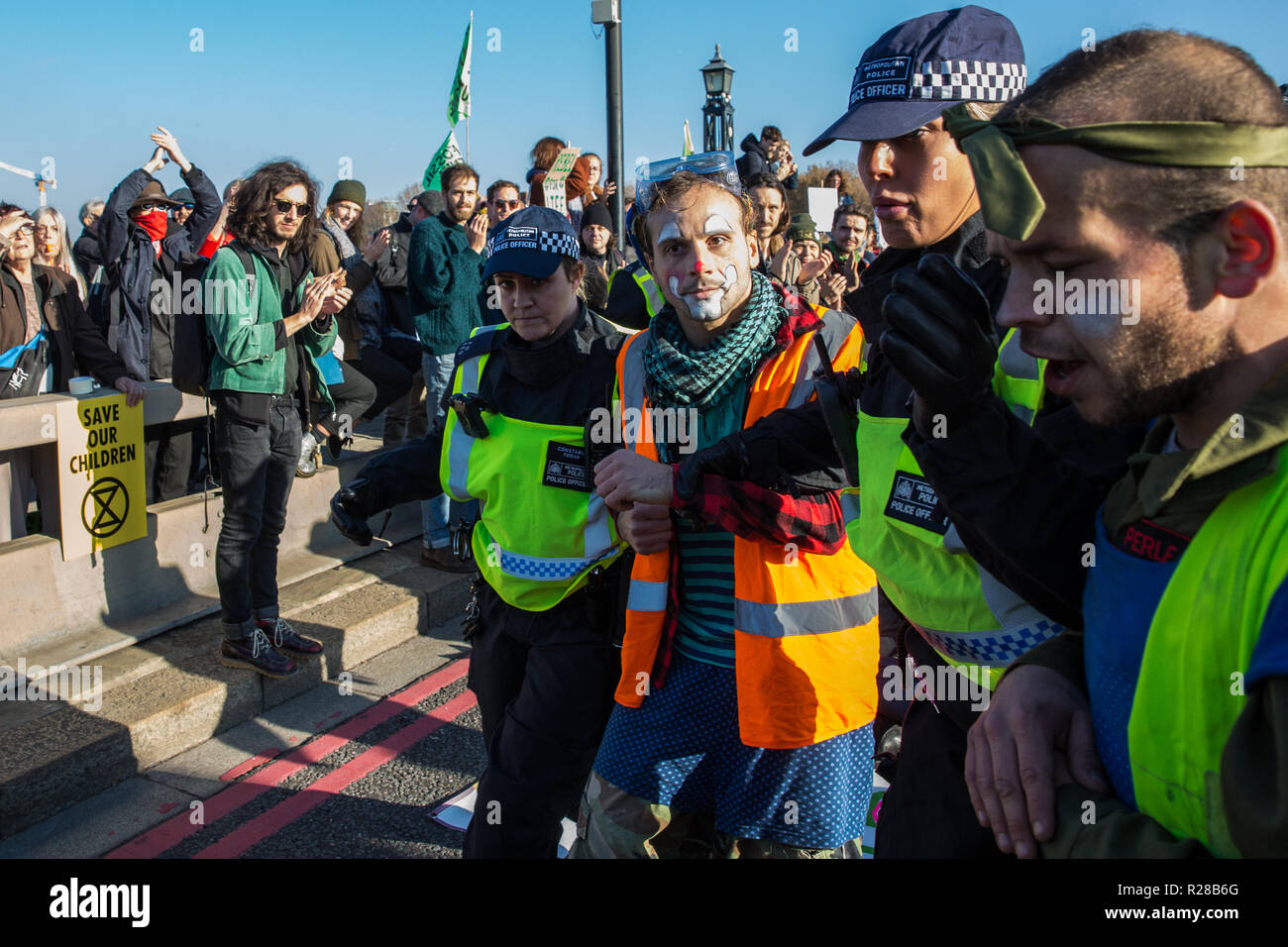 London, UK. 17th November, 2018. Police officers arrest a clown from Clandestine Insurgent Rebel Clown Army (CIRCA) after environmental campaigners from Extinction Rebellion blocked Lambeth Bridge, one of five bridges blocked in central London, as part of a Rebellion Day event to highlight 'criminal inaction in the face of climate change catastrophe and ecological collapse' by the UK Government as part of a programme of civil disobedience during which scores of campaigners have been arrested. Credit: Mark Kerrison/Alamy Live News Stock Photo