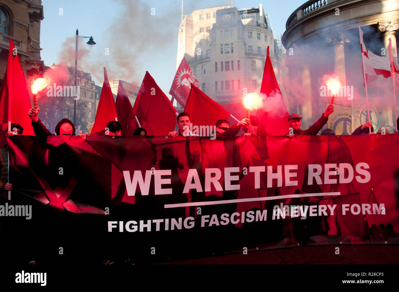 London, UK. 17th Nov, 2018. National Unity Demonstration Against Fascism & Racism, Central London on 17th November 2018 to protest against racist and Islamophobic attacks. A group of mostly young men light red flares and stand behind their banner 'We are the Reds'. Credit: Jenny Matthews/Alamy Live News - Stock Image