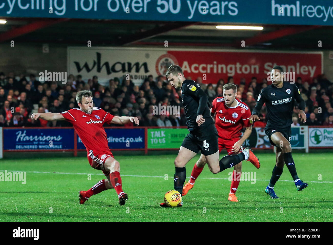 Accrington, UK. 17th November 2018, Crown Ground, Accrington, England; Sky Bet League One, Accrington Stanley v Barnsley ; Liam Lindsay (06) of Barnsley plus the ball in the box as Mark Hughes (03) of Accrington Stanley challenges   Credit: Mark Cosgrove/News Images  English Football League images are subject to DataCo Licence Credit: News Images /Alamy Live News - Stock Image
