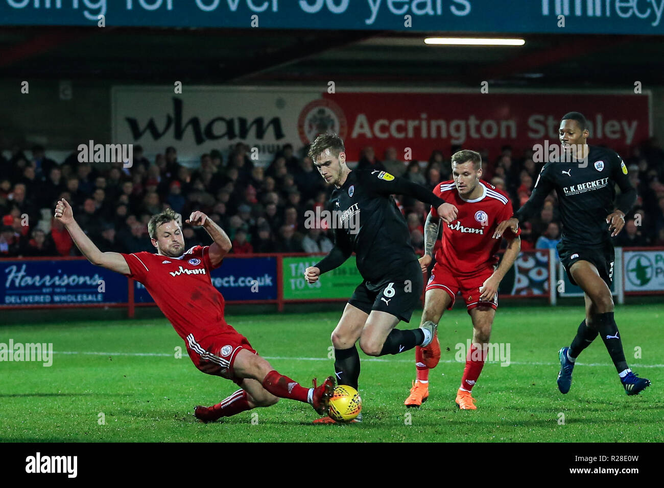 Accrington, UK. 17th November 2018, Crown Ground, Accrington, England; Sky Bet League One, Accrington Stanley v Barnsley ; Mark Hughes (03) of Accrington Stanley slides in to win the ball from Liam Lindsay (06) of Barnsley    Credit: Mark Cosgrove/News Images  English Football League images are subject to DataCo Licence Credit: News Images /Alamy Live News - Stock Image