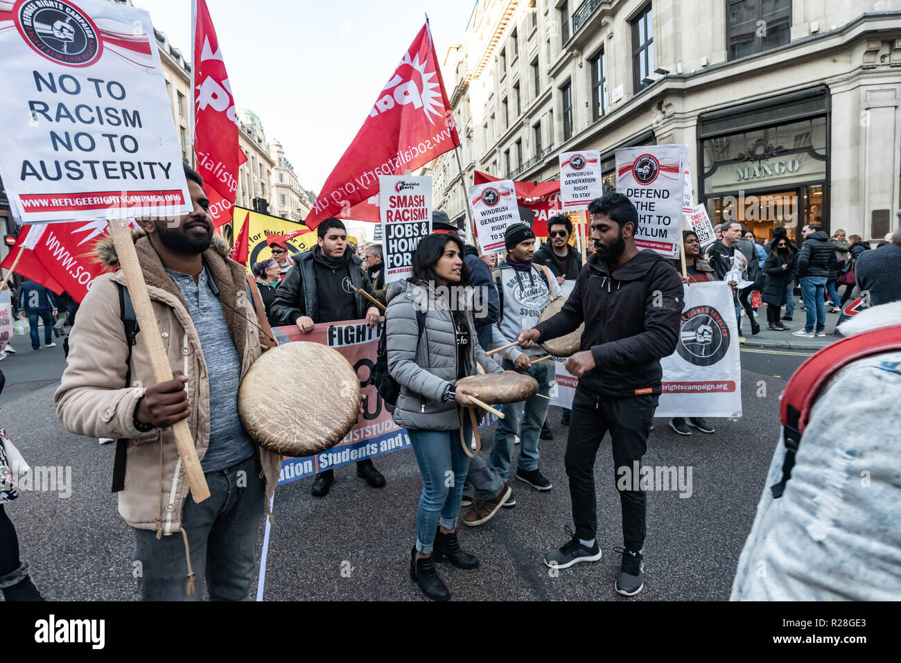 London, UK. 17th November 2018. Drummers for the Refugee Rights Campaign. Thousands marched from the BBC to a rally in Whitehall calling for unity against the rising threat of Islamophobia and Antisemitism by far-right groups in the UK, with a level of support for fascism not seen since the 1930s. The event was initiated by Stand Up To Racism, co-sponsored by Unite Against Fascism and LoveMusic HateRacism, and supported by many other groups and individuals including Diane Abbott MP and John McDonnell MP. Peter Marshall/Alamy Live News - Stock Image