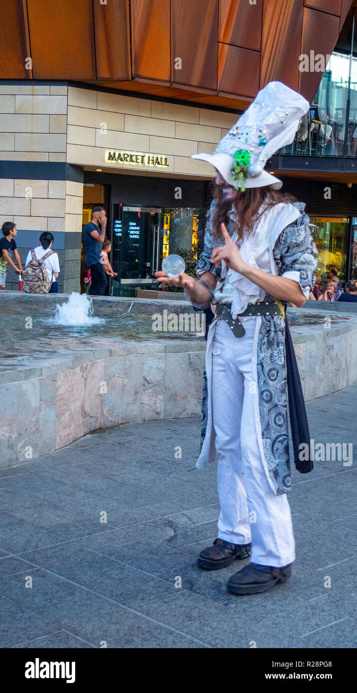 Male magician busking at Yagan Square Perth Western Australia. - Stock Image