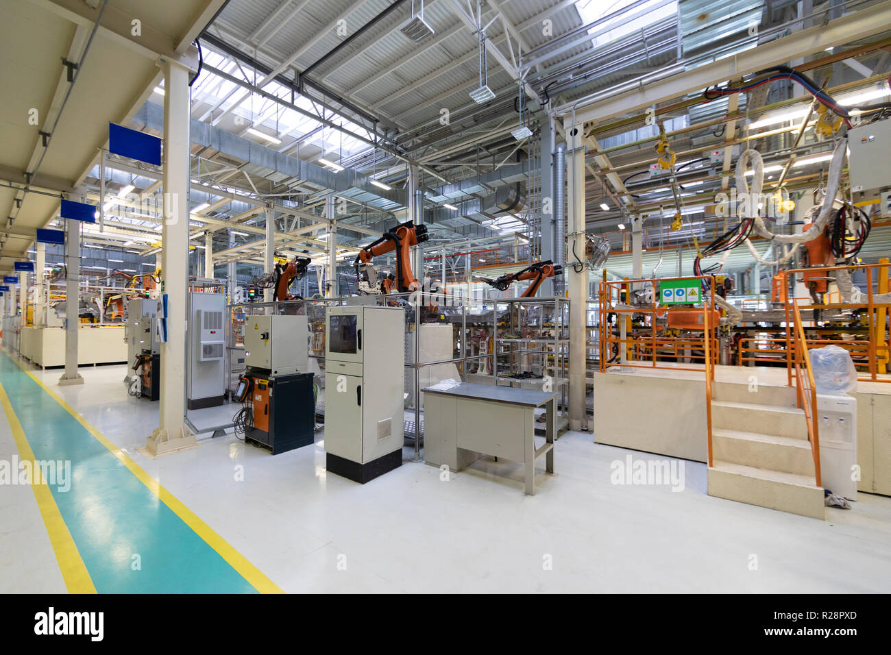 process of welding cars. Modern Assembly of cars at plant. automated build process of car body Stock Photo